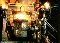 Metal industry. Founding of hot metal into the teeming ladle