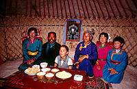 Mongolian family inside yurt. Inner Mongolia. China