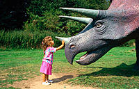 Child in dinosaur park