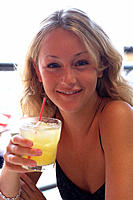 Young blonde girl with cocktail