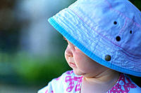 Young child wearing a hat