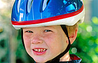 Boy wearing bike helmet