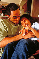 Man tickling his daughter
