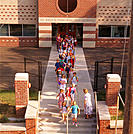 Grade school kids exit school