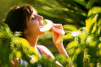 Woman eating fruit