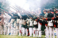 Men firing muskets at Genesse Country Museum. Mumford. USA