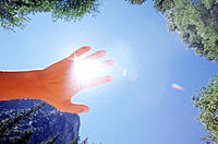 Hand blocking sun