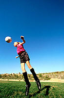 Teen girl playing soccer