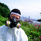 Man wearing a respiratory mask for organic vapors like asbestos, dust and particulate aerosols