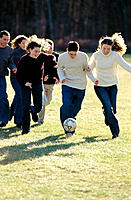 Young people playing football