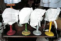 Antique lace bonnets for sale. Antiques dealer window. Normandy. France