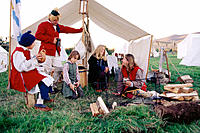 Family in 1700's encampment. Jefferson. New Hampshire. USA
