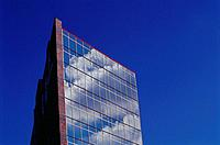 Office building with wall of windows reflecting blue sky and clouds, against deep blue sky, Keystone Crossing, Indianapolis, Indiana, USA