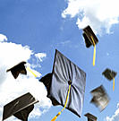 Graduation caps tossed to the sky