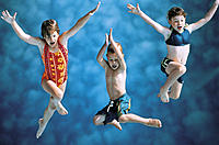 Three children jumping into water (front view)