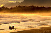 Family walking along beach at sunset, Long Beach at sunset, Pacific Rim Nat Park, BC