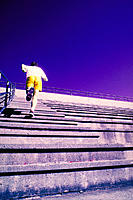 Jogger running up stadium stairs