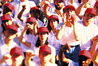 Crowd booing wearing white t-shirts and red caps