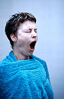 Woman yawning after shower