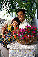 Father and daughter relax on porch w/ flowers B1103