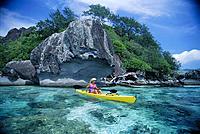Fiji, Kadavu Island, woman kayaking turquoise coast