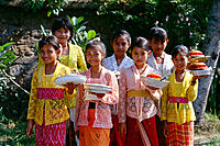 Indonesia, Bali, Tangeb Village, school children in colorful dress, smiling