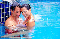 Close couple in swimming pool