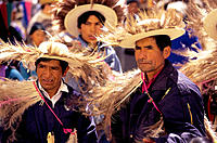 Samilantes (in plumed dresses) at the procession. Casabindo. Jujuy province. Argentina