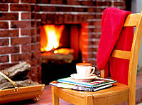 Sweater, chair and fireplace