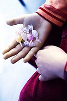 Child's hand and candies