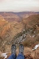Low section view of a hiker´s feet dangling on a cliff, Grand Canyon National Park, Arizona, USA