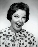 Close_up of a mid adult woman laughing