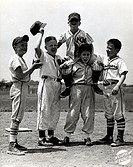 Little league team celebrating their victory
