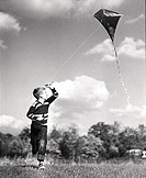 Boy flying a kite in a field