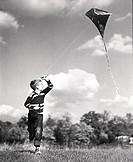 Boy flying a kite in a field