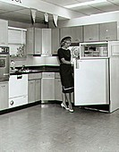 Young woman looking at refrigerators in a store