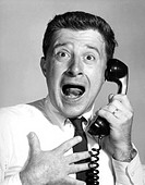 Close-up of a businessman shocked on the telephone