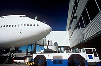 Boeing 747 passenger aircraft at airport terminal gate ready for pushback