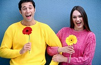 Couple holding gerberas