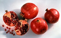 Several Pomegranates, One Cut in Half