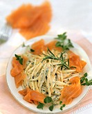 Noodles with salmon, cream sauce and herbs