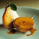 Poached pears in caramel sauce