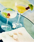 Two Cocktails with Cherry and Lime Garnishes