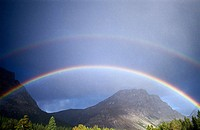 Rainbow over mountains. Banff National Park. Alberta. Canada