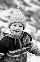 young boy dressed for winter, smiling