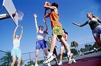 Girls and guys playing basketball