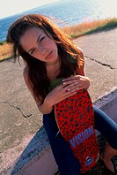 Portrait, Teenaged Girl with Skateboard