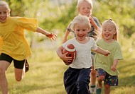 Group of Children Playing, Girl Running with Football