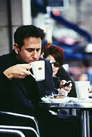 CREDIT: MICHAEL DONNE/SCIENCE PHOTO LIBRARY  Drinking coffee.    Man  drinking coffee  at a cafe.  He is making a hands-free call on his mobile teleph...