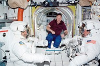 ISS astronauts preparing for a space walk (extravehicular activity, EVA) in the Quest Airlock on the International Space Station (ISS). Jerry L Ross (...